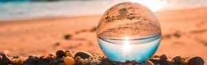 Glass sphere on beach