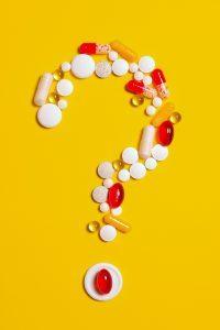 A question mark made of pills